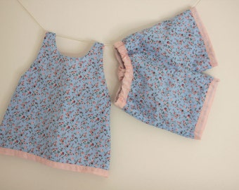Top and shorts set pale blue with a pink floral pattern and fully lined in pink.