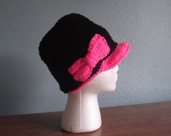 Black beanie with hot pink bill and bow