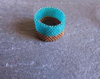 Miyuki ring in caribbean teal and bronze.