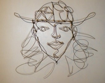 Woman w/ Hat--3-D steel wire sculpture