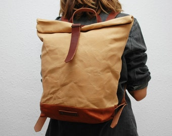 waxed Canvas rucksack/backpack,  vanilla color, hand waxed , with handles, leather base and closures