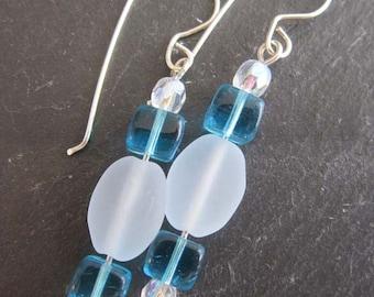 Glass dangle earrings.