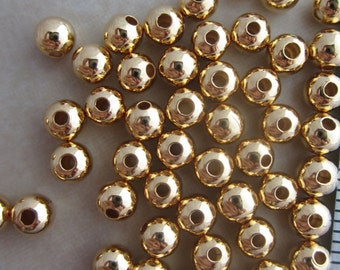 200 gold plated 4mm round beads