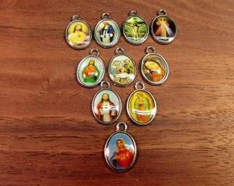 15mm x 10mm x 1.8mm (3/8 x 1/2 in)Oval Pendant. Christian Pendant. Religious Charm. Jesus Charm. Mary Charm. Chirstian Charm. Enamel Charm.