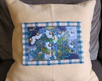 Appliqued throw pillow with yellow and yellow and blue check coordinating fabric with original daisy painting applied to front.
