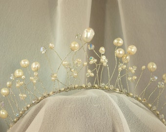 Handmade tiara made with quality pearls, Swarovski beads, beading wire on metal hairband
