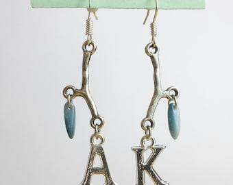 Silver twig, light blue daggers and silver Ak dangle earrings