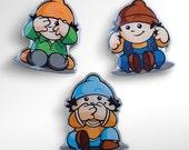 3 pins - hear see speak no evil - three gnomes like the three monkeys