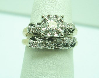Vintage gold and diamond engagement and wedding set.