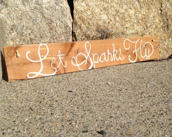 Let Sparks Fly Sign