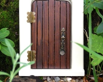 Delightful walnut and cream coloured wooden fairy door for Wooden fairy doors