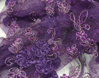 Purple/ plum with silver,flowers sequins lace on a mesh embroider.36x50 inches.sold by the yard.