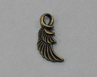 Free Shipping Antique Brass Sculpted Wing Charm