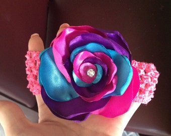 Elastic headband with silk flower and embellishment