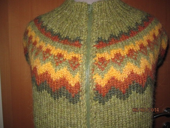 Green traditional Icelandic sweater Lopapeysa by Baldursheimur
