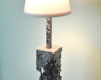 Concrete lamp with voids