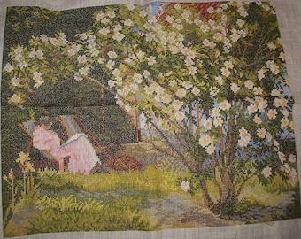 Completed Crossstichwork woman near rosebush Eva Rosenstand