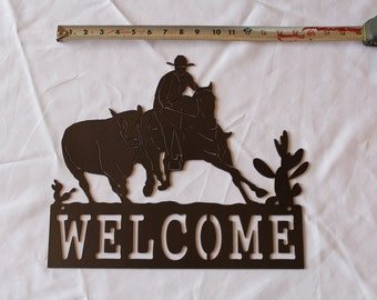 Cowboy with Cow Welcome Sign