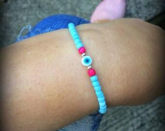 Handmade beaded bracelet with mini Evil Eye bead