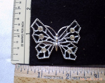 Rhinestone and silver butterfly pin