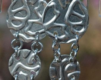 Receding aluminium earrings