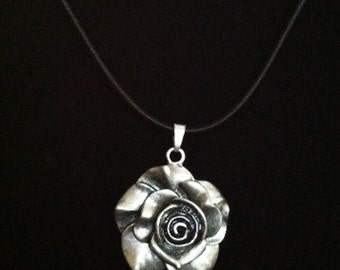 Rose pendant on cotton necklace base