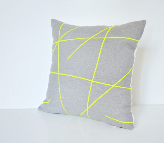 Neon yellow design on grey linen pillow cover
