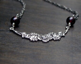 flowers and garnet necklace
