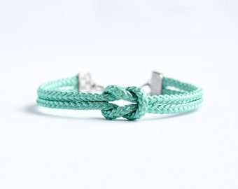 Turquoise blue forever knot nautical rope bracelet with silver or gold anchor charm