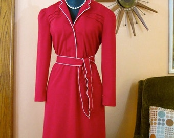 70s does 40s red StarShine dress: pleating and piping