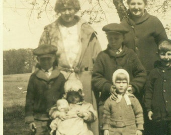 1920s Girl Holding Doll Toy in Family Picture Women Boys Antique Vintage Black White Photo Photograph