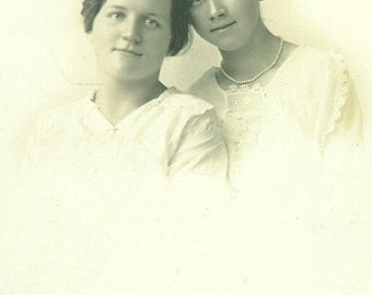 Sisterly Love Young Women Girls Heads Touching Portrait Picture Sister RPPC Real Photo Postcard Vintage Antique Black White Photo Photograph