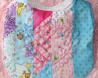 Patchwork Bib quilted with feathered heart