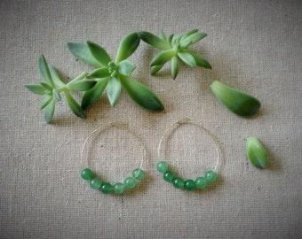 Natural green beaded hoop earrings