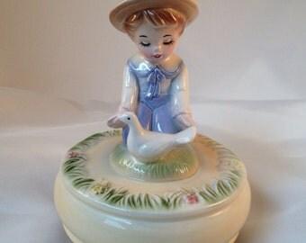 Vintage ceramic Schmid Japan boy with duck music box