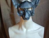 Leather mask of fox gargoyle, ghostly mammal, stone chimera