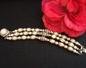 Three strand Pearl and crystal bracelet