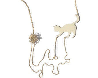 Cat necklace -Ivory acrylic silhouette of a cat playing with wool