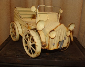 "Wind up this little ""Tin Lizzie"" (or Tin Lizzy) and let the music play!"