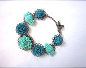 Cabochon bracelet in teal and darker mint green