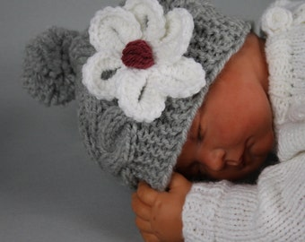 Baby girl knit hat with a flower. 0-3, 3-6, 6-8, 8-12 months.