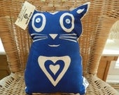 Hand screen printed blue and cream , cat shaped cushion, vintage button eyes.