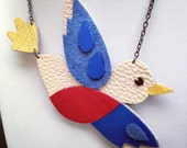 Flying bird necklace in blue, red, cream and yellow leather - hand-cut graphic jewellery - upcycled leather jewellery by DustyDoes