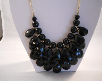 3 Strand Bib Necklace with Black Teardrop Beads on a Gold Tone Chain with Matching Earrings