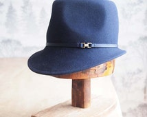 Monique: Navy  men's weight fur felt modified fedora with navy leather trim and antique brass finding