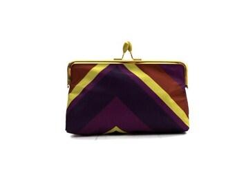 purple striped kiss lock pouch / cosmetics bag / vintage clutch