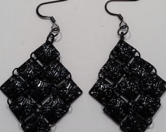 Black filigree earrings.
