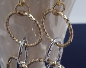 Silver and gold loop earrings.