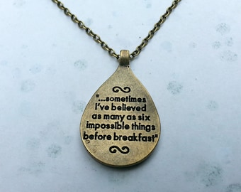 "Alice in Wonderland quote ""sometimes I've believed as many as six impossible things before breakfast"" reversible bronze necklace."
