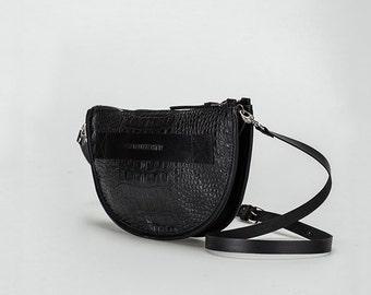 Half-rounded handbag clucth